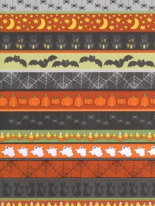 Halloween symbols make monstrously fun patterns on craft paper for poetry writing!