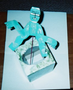 A Pop up puppet made by a student using recycled paper and a reused tissue box