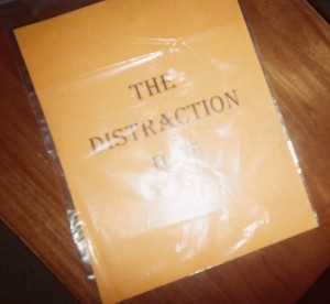 A DISTRACTION BAG can simply be a large clear, easy-to-open plastic bag with a title page that identifies its purpose.