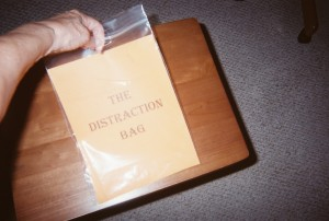 """Good morning! Please drop your distractions in the DISTRACTION BAG before we start the day."""