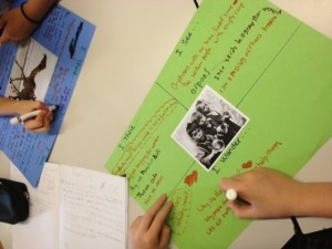 """Students in Karen Walsh's class design posters that invite them to become """"agents for change."""""""