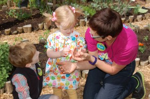 A young visitor to Marbles is delighted to make a Power Flower spin with solar energy in Castaway Cove.
