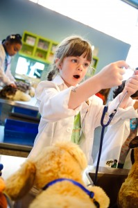 """I'm going to check this puppy's heart,"" says a girl in Marbles Pet Vet play-to-learn space."