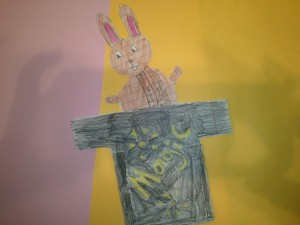 Surprise! Pull on the pink ears poking up from a paper t-shirt and a little bunny poem appears!